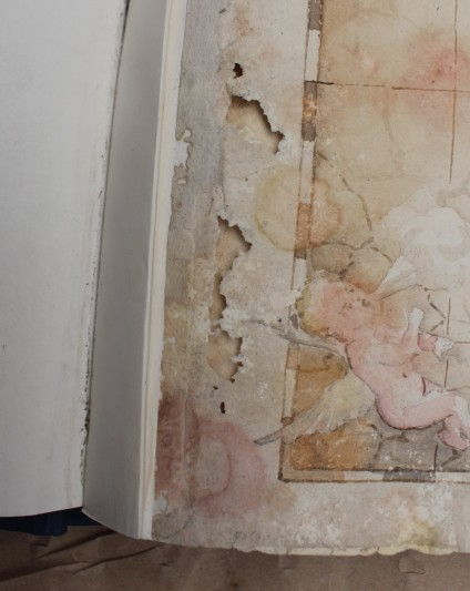 Folio of watercolours, detail of damage - before