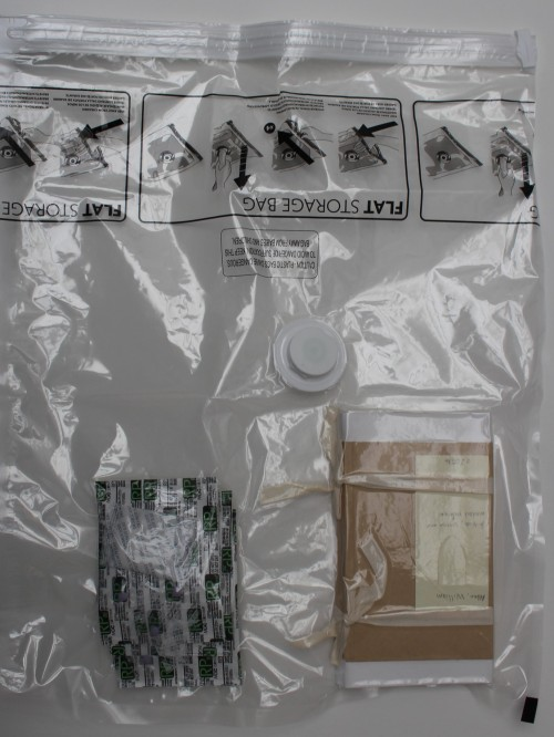 Mould-damaged book in vaccum bag showing seal